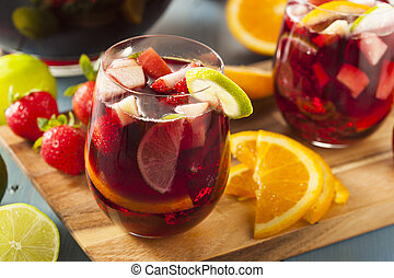Homemade Delicious Red Sangria with Limes Oranges and Apples