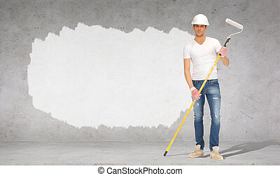 handsome painter in helmet with paint roller - construction,...