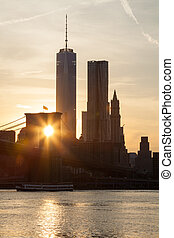 Lower Manhattan and Brooklyn bridge in New York at sunset - USA
