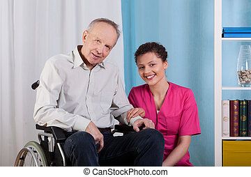 Disabled man and nurse in a hospice
