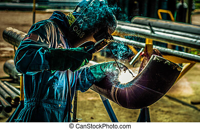 The Pipe Welder - A portraiture of a pipe welder at a...