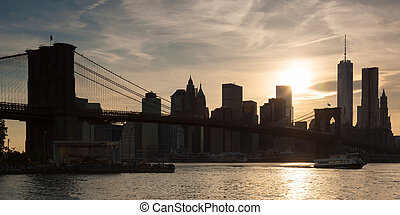 Panoramic view of lower Manhattan and Brooklyn bridge in New...