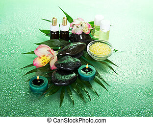 Spa set. Oils, candles and stones - Spa set on a background...