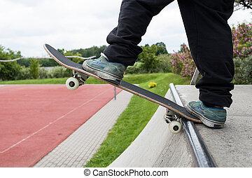 Skate girl doing tricks on skateboard