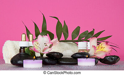Candle, flower, stones, before a howea leaf - Candle, stones...