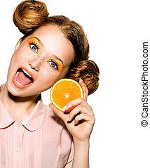 Beauty Model Girl with Juicy Orange. Joyful Teen Girl