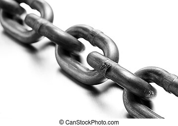 industrial chain macro on brushed metal, white background