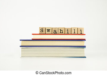 swahili language word on wood stamps and books - swahili...
