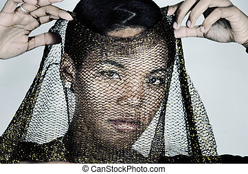 Fashion woman with veil - Portrait of young serious african...