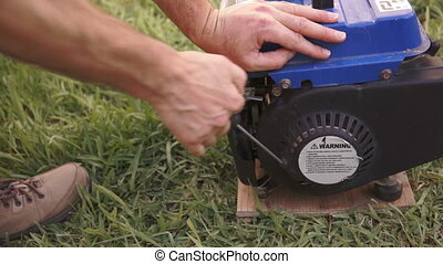Industrial Pull Start Generator - Close up shot of a man in...