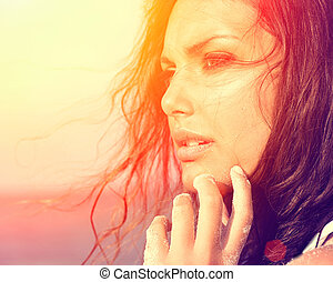 Beauty Sunshine Girl under the Hot Sun on the Beach