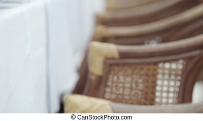 Wicker armchairs - Several wicker chairs before a table...