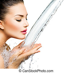 Beautiful woman with splashes of water in her hands