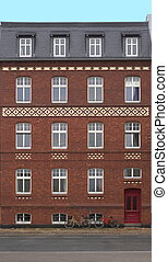 Face Of A Red Bricked House - Front view of a red row house...