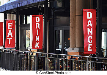 Outdoor Restaurant - Outside rend signs EAT, DANCE, DRINK at...