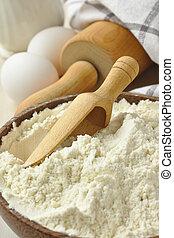 Homemade gluten free flour blend in wooden bowl met scoop -...