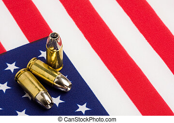 bullets over US flag - bullets 9mm closeup over US flag