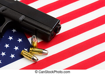 gun over american flag, modern 9mm handgun with bullets