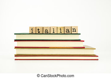italian language word on wood stamps and books - italian...