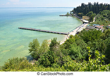 Beach of Sirmione town Lake Garda, Italy