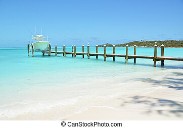 Yacht at the wooden jetty. Exuma, Bahamas
