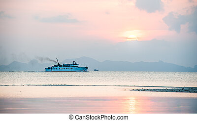 transport ship - boat on the ocean at sunset