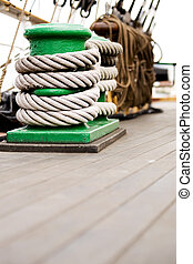 rope on cleat schooner deck - rope wrapped around cleat of...