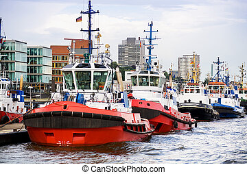 tugboats in a row - tugboats waiting in a row at pier
