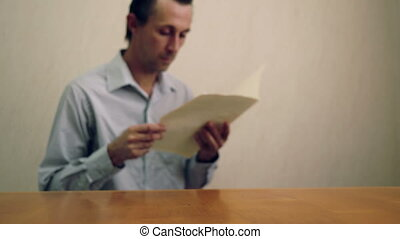 Male Reading and Throwing File Fold - Male reads contents of...