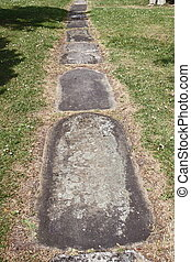 Churchyard path paved wtih old tombstones