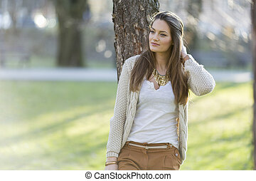 Pretty young woman in the park