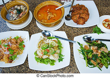 Assorted Thai food, Tom Yam Talay, Kaeng Massaman Gai, Tot...