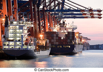 ships in harbor - giant freighters in port being loaded with...