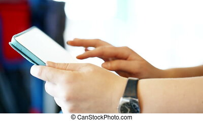Close-up shot of woman working with touchpad