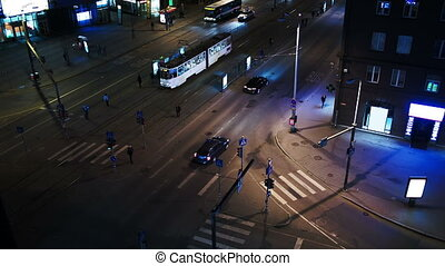 Evening city traffic in Tallin, Estonia. Crossroad with public transport stops