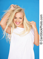 Beautiful young blond with a vivacious smile