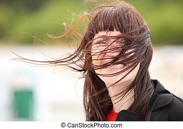 Woman of which in face blows marine wind