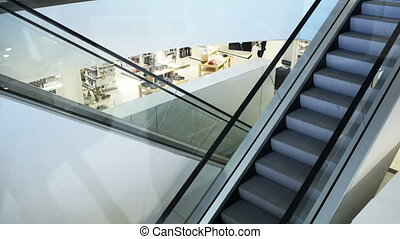 Empty moving staircase in trade center - Empty moving...