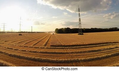 Aerial of harvesting a grainfield wirth a combine harvester...