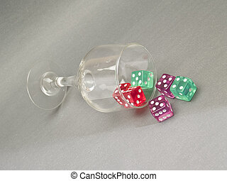 glass cup with dice