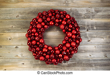 Large Christmas Wreath on Faded Wood - Top view of a large...