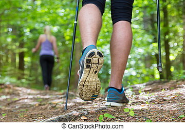 Young couple hiking in nature Sport and exercise - Young fit...