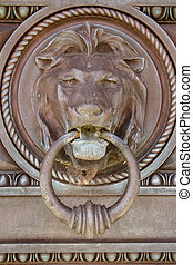 Metal Lion door knocker - Vertical shot of closeup view of...