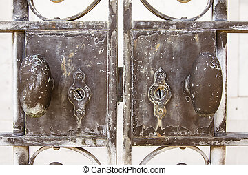 Metal gate locks - Close up view of weathered locks on old...