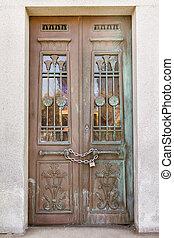 Mausoleum door - Front view of weathered mausoleum door