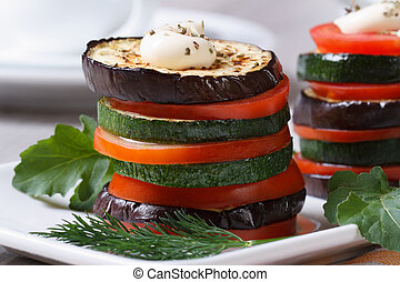 vegetarian appetizer of roasted vegetables with sauce