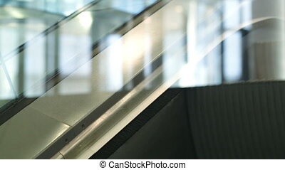 Close-up shot of escalator going up - Close-up shot of...