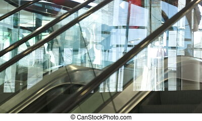 Up and down escalator with people riding