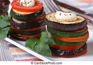 Eggplant, zucchini and tomatoes on a plate