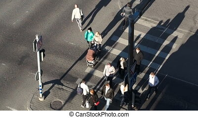 People crossing the street on green light - High angle shot...
